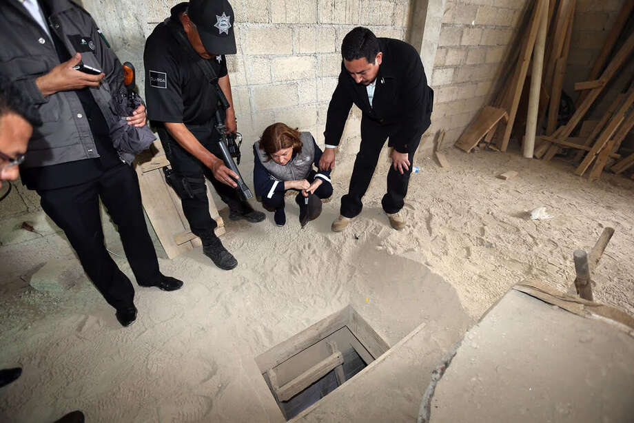 "In this photo provided by Mexico's attorney general, authorities inspect the exit of the tunnel they claim was used by drug lord Joaquin ""El Chapo"" Guzman to break out of the Altiplano maximum security prison in Almoloya, west of Mexico City, Sunday, July 12, 2015. A massive manhunt is underway after Guzman, escaped from the maximum security prison through the tunnel that opened into the shower area of his cell, the country's top security official announced. (Mexico's Attorney General's Office via AP) Photo: Mexico's Attorney General's Offi, HOGP / Associated Press / Mexico's Attorney General's Offi"