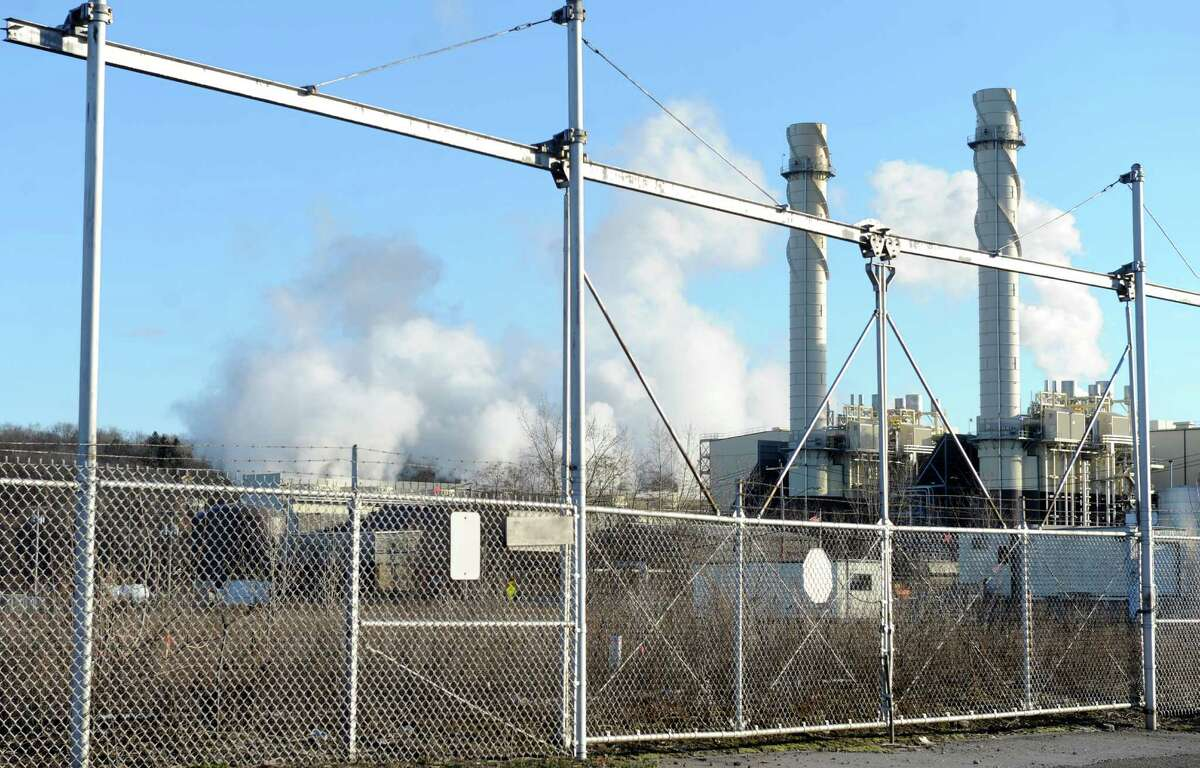 Empire Generating Co. power plant Tuesday, Dec. 30, 2014, in Rensselaer, N.Y. RGGI sets a limit on power plant emissions and requires plant owners to buy state-auctioned pollution credits to cover those emissions. (Michael P. Farrell/Times Union archive)