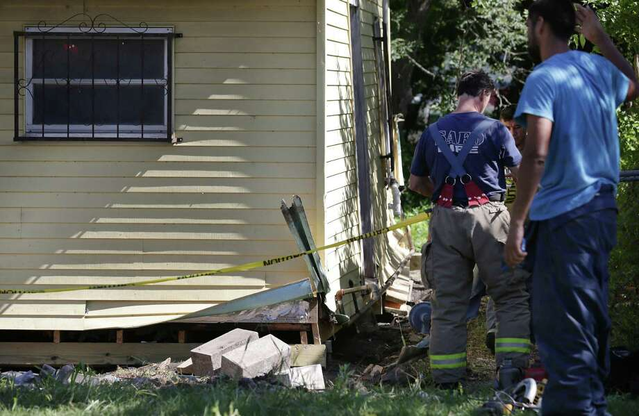 A foundation construction worker was trapped under a house after a foundation jack slipped on the house that he and a crew of about 4 others was lifting to repair the foundation at the home at 510 Sterling.  Fast thinking co-workers placed another jack close by and lifted the house a bit relieving the pressure on the trapped worker. Fire Fighters were able to rescue the man and he was transported in critical condition, on Wednesday, July 15, 2015. Photo: Bob Owen, San Antonio Express-News / San Antonio Express-News