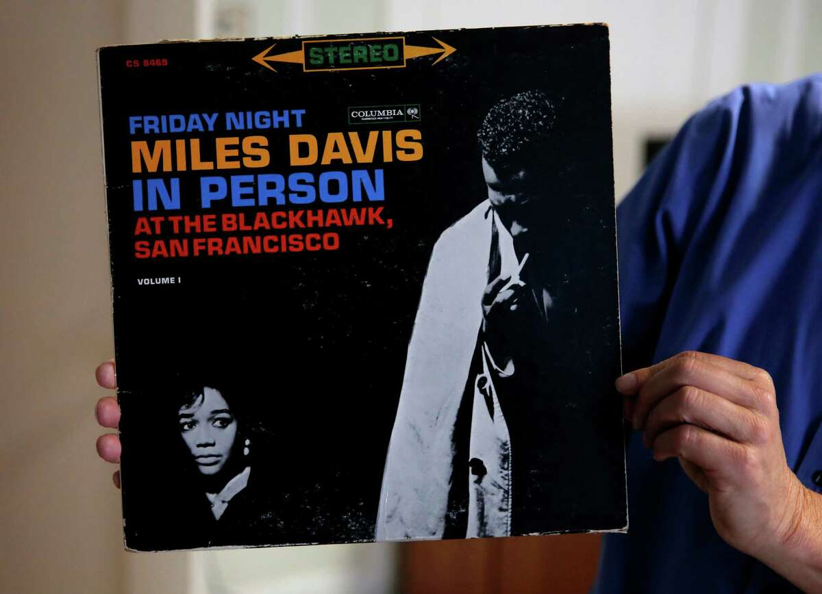 Randy Shaw, director of Uptown Tenderloin, holds a Miles Davis album recorded live at The Black Hawk, an old jazz club in the Tenderloin, while in his office in San Francisco, California, on Tuesday, July 14, 2015. Memorabilia like this will populate the new Tenderloin Museum.