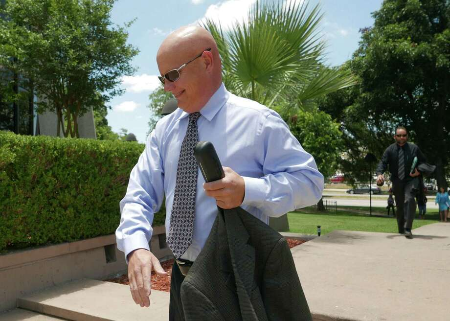 Former 144th District Judge Angus McGinty arrives at the federal courthouse for sentencing in his bribery case on Wednesday, July 15, 2015. He was sentenced to two years in prison. Photo: Billy Calzada, Staff / San Antonio Express-News / San Antonio Express-News