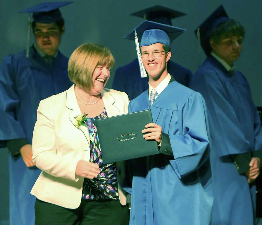 Class of 2015 president Ross Grappotte enjoys his moment center stage with Glenholme School Principal Sharon Murphy while receiving his diploma during the school's 11th annual commencement exercises in Washington. Photo: Contributed Photo / Contributed Photo / The News-Times Contributed