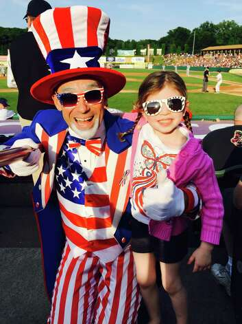 4-year old Rebecca enjoying uncle Sam's company at the July 3rd Valley Cats game. (Lianne Pinchuk Wladis, Bethlehem)