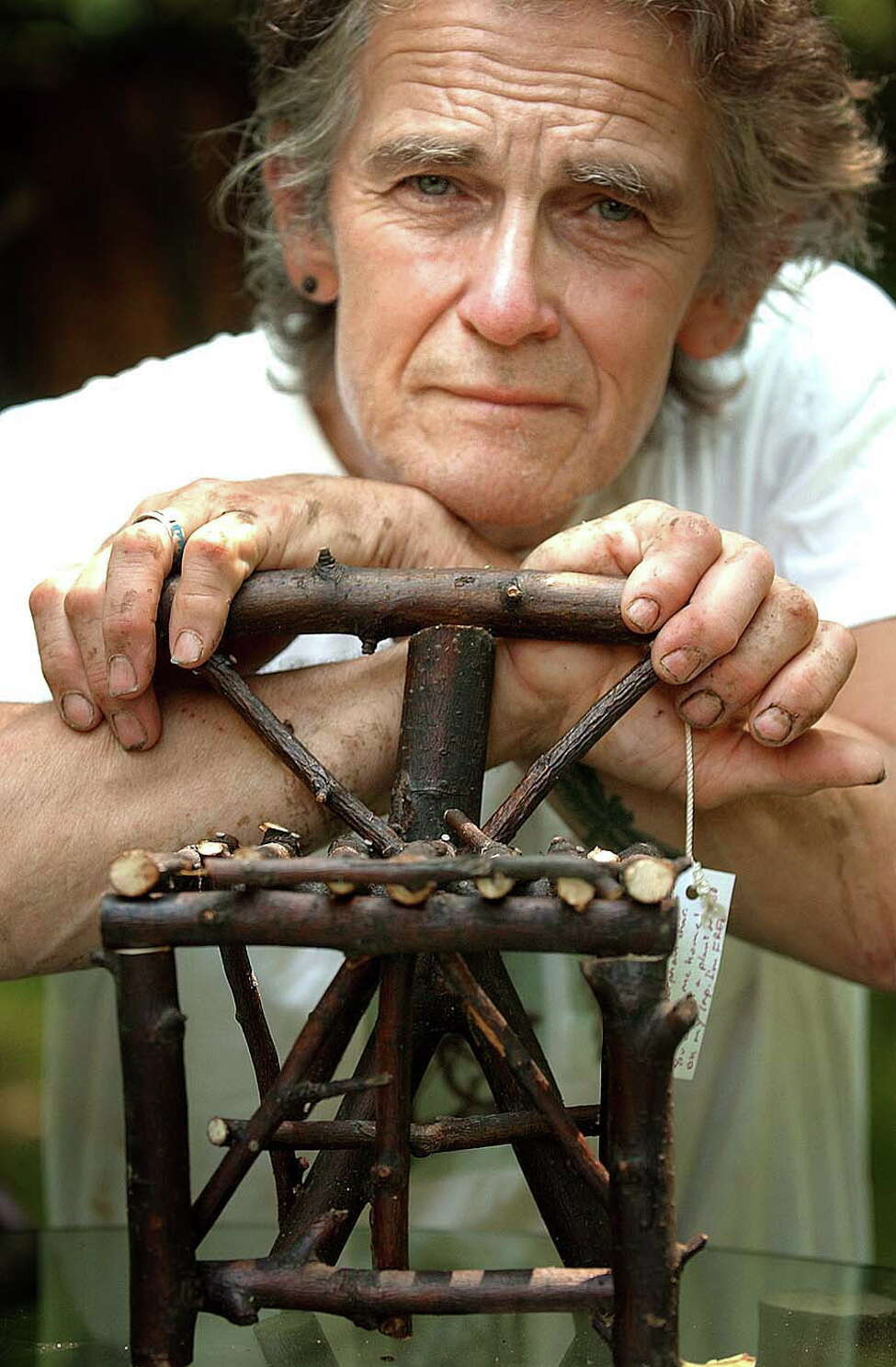 Paul Weinman and one of his miniature chairs that he made, Monday, June 27, 2005, in Albany, N.Y. (Steve Jacobs/Times Union)