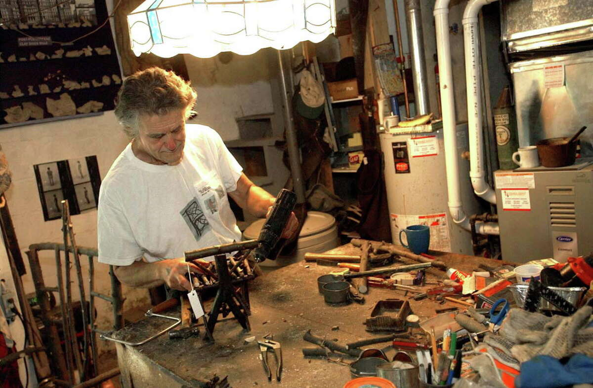 Paul Weinman makes one of his miniature chairs in his garage Monday, June 27, 2005, in Albany, N.Y. (Steve Jacobs/Times Union)