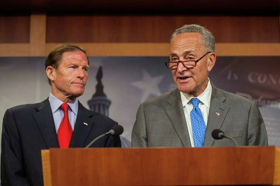 Sen. Richard Blumenthal (D-Conn.), left, and Sen. Chuck Schumer (D-N.Y.), speak during a news conference at the Capitol in Washington, July 15, 2015. Senate Democrats on Wednesday revealed legislation to give entities in Puerto Rico the same Chapter 9 bankruptcy protections that similar entities in the U.S. enjoy. (Zach Gibson/The New York Times) Photo: ZACH GIBSON / NYTNS