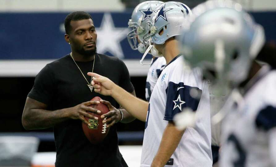 Dallas Cowboys wide receiver Dez Bryant, left, listenes to Tony Romo (9) during an NFL football mini