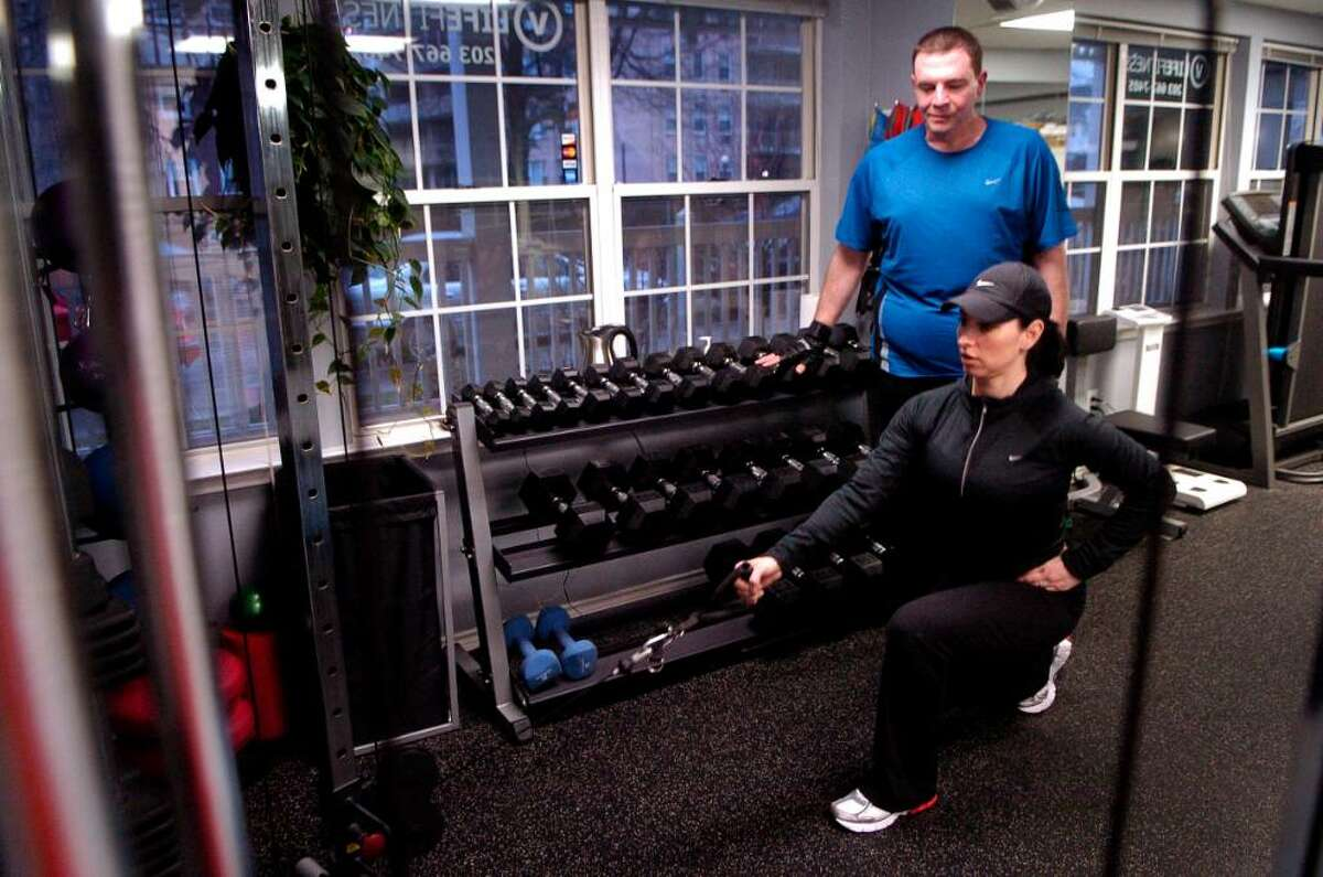 Veronica Thomas, owner of VLife Fitness in Stamford, Conn., trains Gene Ceriello on Friday March 12, 2010 who with her help has lost 150 lbs.