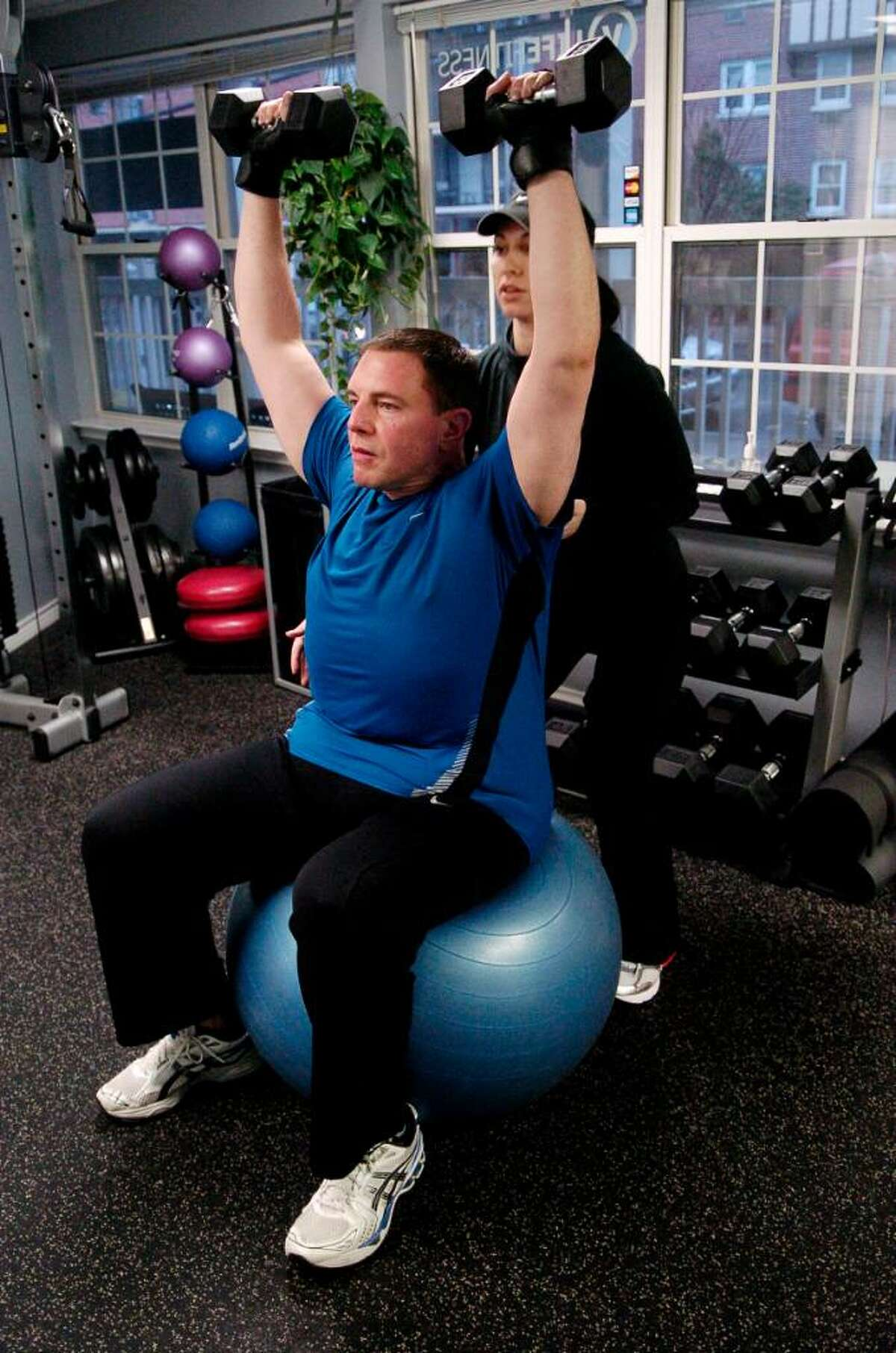 Veronica Thomas, owner of VLife Fitness in Stamford, Conn., trains Gene Ceriello on Friday March 12, 2010, who with her help has lost 150 lbs.