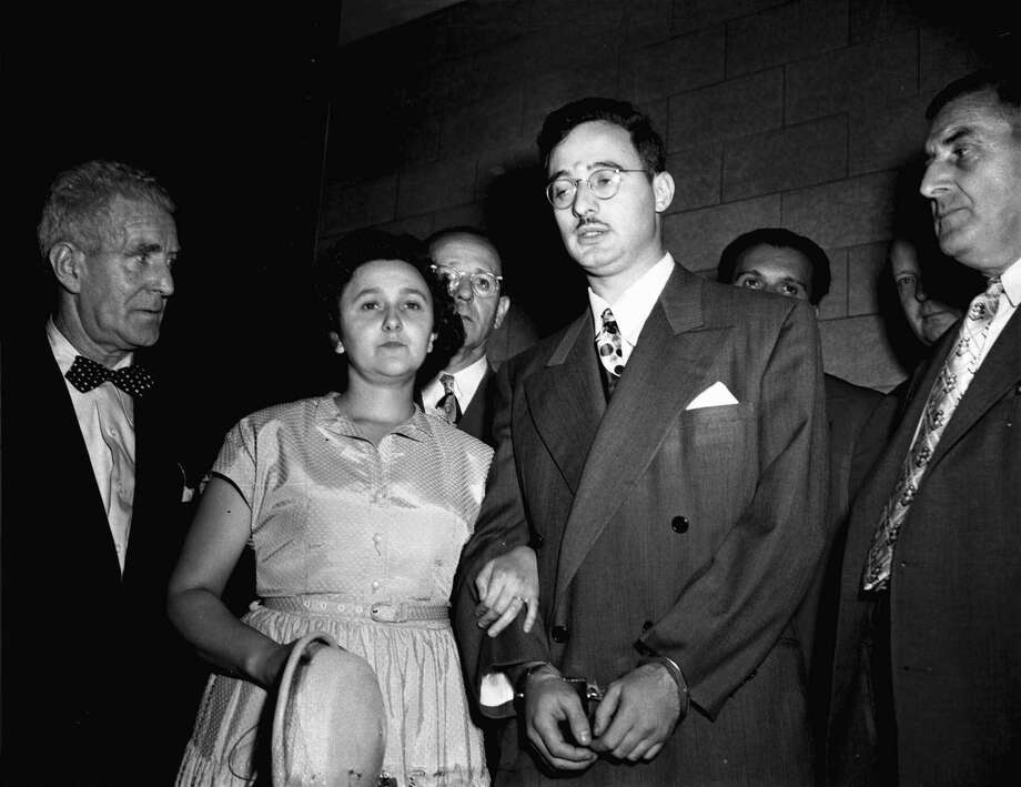 "FILE -  In this 1951 file photo, Ethel and Julius Rosenberg are shown during their trial for espionage in New York.  The couple is accused of conspiring to recruit her brother, David Greenglass, into gathering ""classified information concerning the atomic bomb for the Soviet Union."" The federal government has unsealed new grand jury testimony in the sensational Cold War spying case of Julius and Ethel Rosenberg. The couple was executed in 1953 after being convicted in New York of conspiring to give atomic secrets to the Soviets. The previously sealed testimony is from David Greenglass, the brother of Ethel Rosenberg and the government's star witness in the trial. (AP Photo, File) Photo: Associated Press / AP"