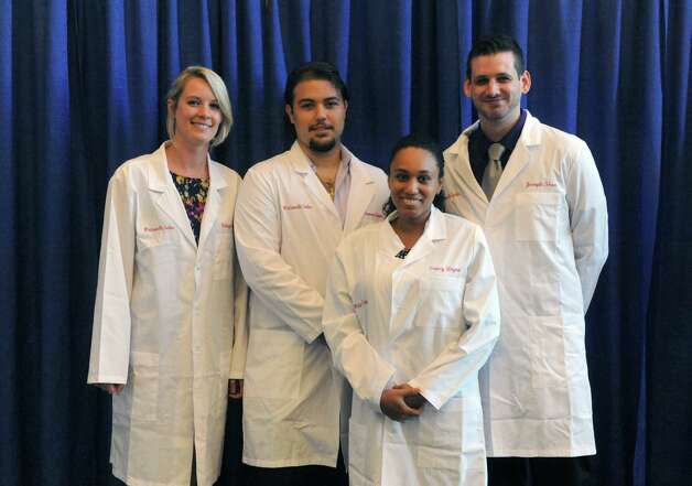 Wadsworth Master of Science in Laboratory Sciences program graduates, left to right, Kaleigh Ahern,, Francesco Criscuolo, Greicy Zayas and Joseph Shea during their commencement on Wednesday July 15, 2015 in Albany, N.Y. (Michael P. Farrell/Times Union) Photo: Michael P. Farrell / 00032610A
