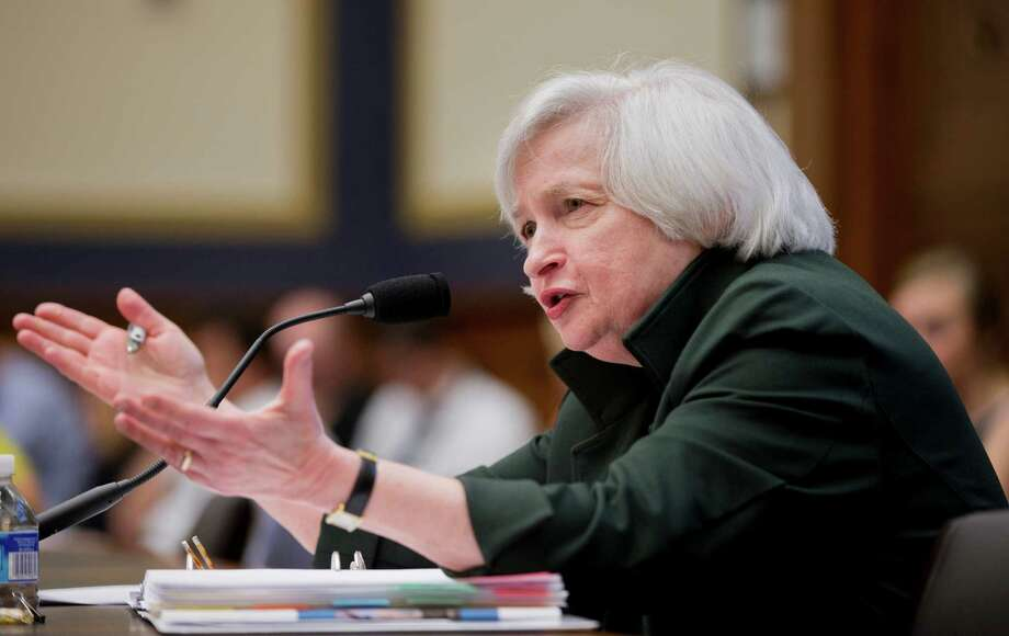 Federal Reserve Chair Janet Yellen blames the fall of oil prices and the rise in the dollar's value for holding back inflation. Photo: Manuel Balce Ceneta, STF / AP