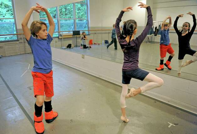 Dancers Philip Ducos, 12-years-old, and Natalie Glassie, 11-years-old, both of NYC, warm up in preperation of the New York City Ballet's Saratoga Premiere of La Sylphide at SPAC on Wednesday July 15, 2015 in Saratoga Springs, N.Y. (Michael P. Farrell/Times Union) Photo: Michael P. Farrell / 00032627A