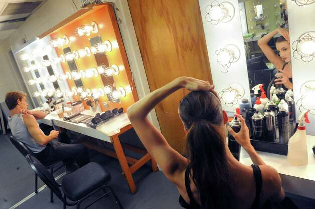 Dancers Adrian Danchig-Waring, left, and Mimi Staker do hair and makeup in preperation of the New York City Ballet's Saratoga Premiere of La Sylphide at SPAC on Wednesday July 15, 2015 in Saratoga Springs, N.Y. (Michael P. Farrell/Times Union) Photo: Michael P. Farrell / 00032627A
