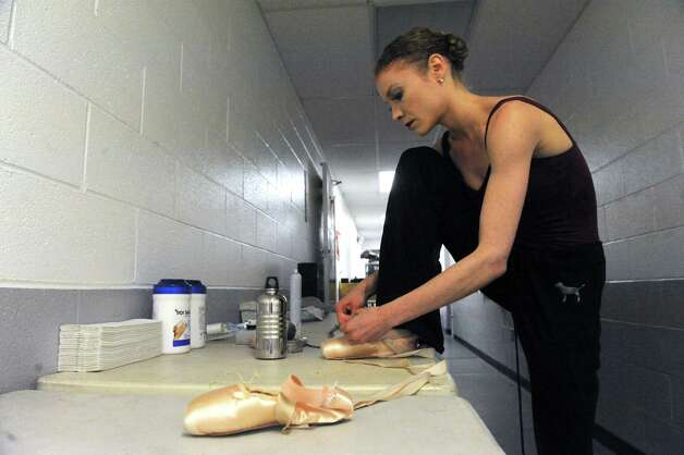 Ballerina Lauren King works on her ballet shoes in preperation of the New York City Ballet's Saratoga Premiere of La Sylphide at SPAC on Wednesday July 15, 2015 in Saratoga Springs, N.Y. (Michael P. Farrell/Times Union) Photo: Michael P. Farrell / 00032627A