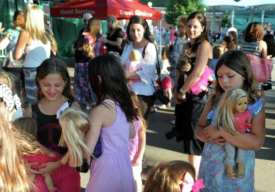Young ladies with their American Girl dolls in tow wait to use a photo booth on American Girl Night and the New York City Ballet's Saratoga Premiere of La Sylphide at SPAC on Wednesday July 15, 2015 in Saratoga Springs, N.Y. (Michael P. Farrell/Times Union) Photo: Michael P. Farrell / 00032627A