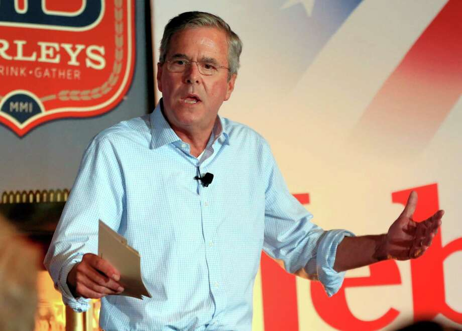 In this July 14, 2015, photo, Republican presidential candidate former Florida Gov. Jeb Bush speaks during a meet and greet event in Council Bluffs, Iowa. The 2016 presidential contest is barely underway, and already donors have poured some $377 million into it, an Associated Press review shows. Bush's money looks different. Before he officially declared his candidacy he spent the first six months of the year raising huge sums of money for Right to Rise, a super PAC that's boosting his bid to win the Republican nomination. That group says it has raised a record $103 million. Bush's presidential campaign, which officially began on June 15, collected $11.5 million from contributors.  Clinton, the Democratic front-runner, has raised $45 million in checks of $2,700 or less for her campaign. Priorities USA Action, a super PAC that counts on seven-figure donors, raised an additional $15 million.  (AP Photo/Nati Harnik) Photo: Nati Harnik, STF / Associated Press / AP