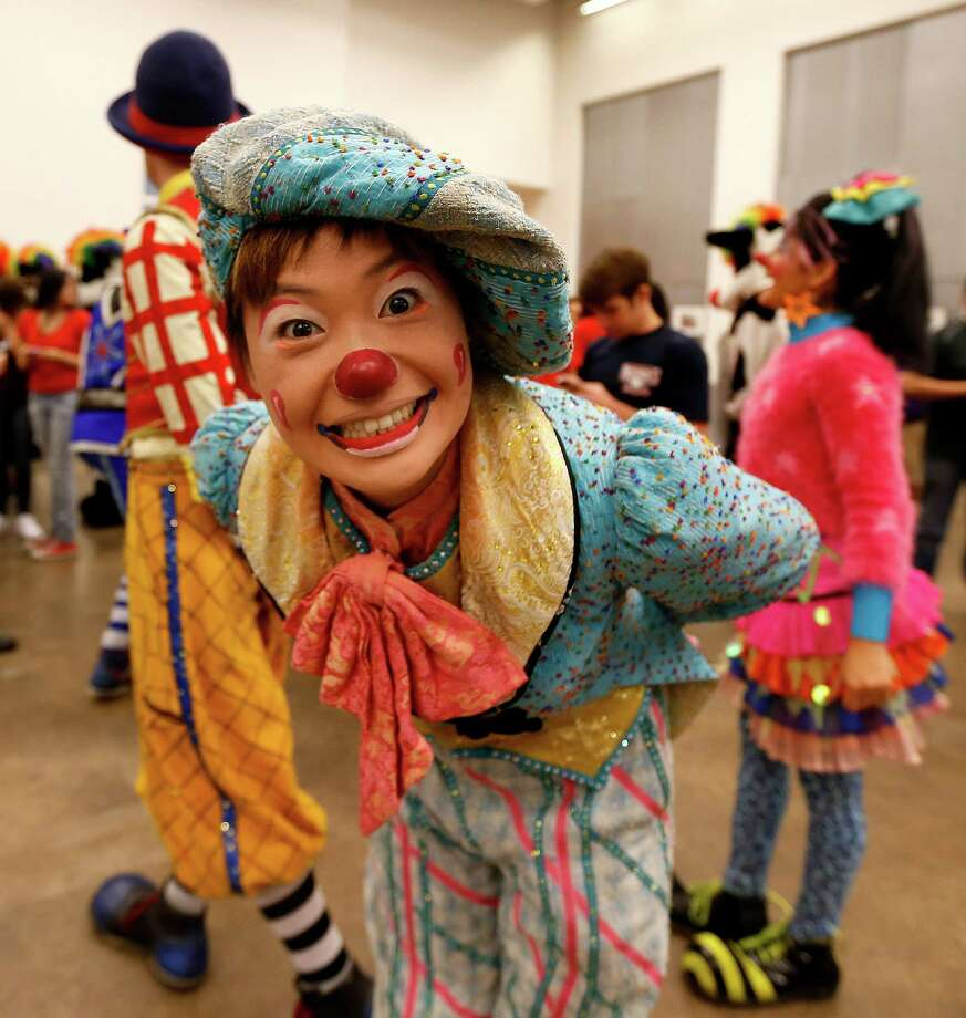 Ringling Bros. and Barnum & Bailey Circus clown Mariko Iwasa mugs the camera as she and other members of the circus performed a mini-show for volunteers at the Houston Food Bank on Wednesday, July 15, 2015, in Houston. Photo: Karen Warren, Houston Chronicle / © 2015 Houston Chronicle