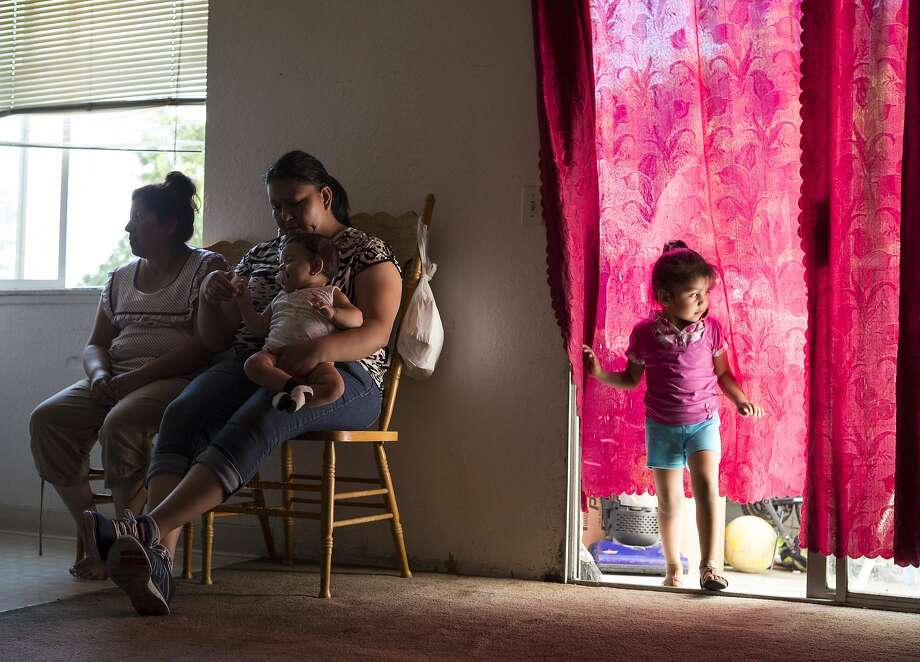 From right: Yuritzy Ortiz, 4, is looked after by mother Noelia Ortiz and aunt Belen Ortiz at the Prentice Apartments in Healdsburg. Photo: Loren Elliott, The Chronicle