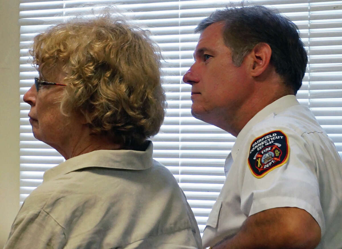 Human Resources Director Mary Carroll Mirylees and Asst. Fire Chief Chris Tracy at Wednesday's Board of Selectmen meeting. The selectmen heard an update on new contracts for both firefighters and police officers.