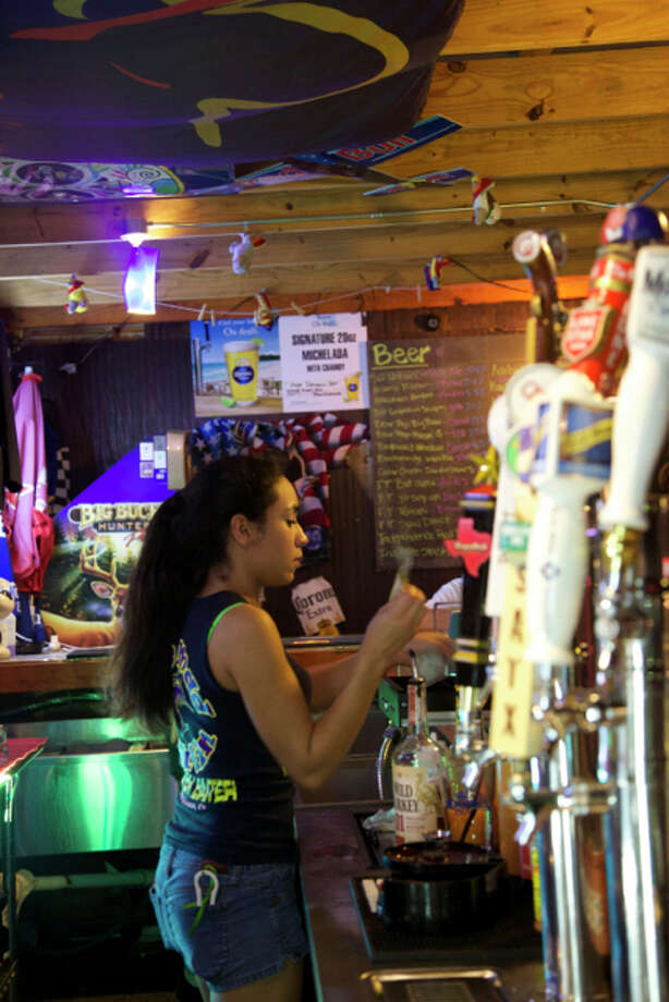 Martisa Benavides is working the bar at Mad Marlin. Photo: Photos By Xelina Flores / For The Express-News