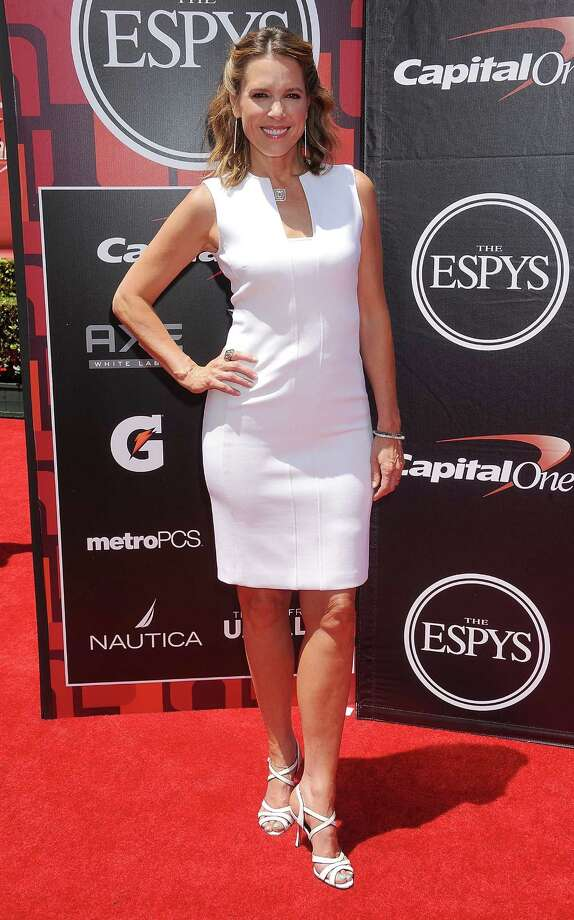 Sports Journalist Hannah Storm keeps it simple in a fitted white dress. While it may look great, it feels a little like a brunch-at-the-country-club-with-the-girls look. Photo: Gregg DeGuire, Getty Images / 2015 Gregg DeGuire
