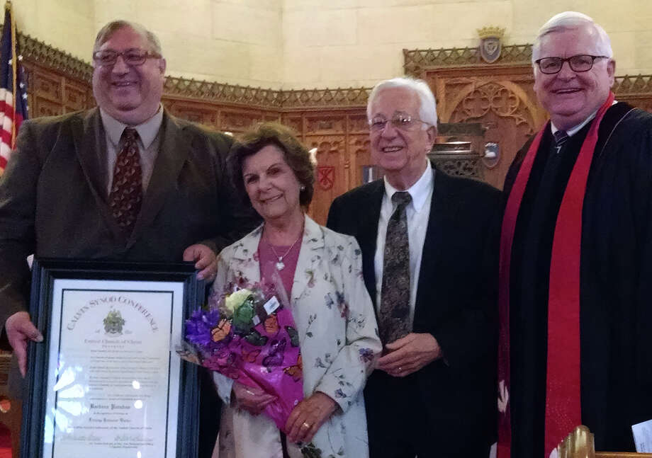 """Barbara Poruban of Fairfield, second from left, was recently presented with the """"Lifelong Dedicated Worker"""" Award from the Calvin Synod Conference of the United Church of Christ. With her at the recent presentation were, from left, Calvin Synod Conference Presbyter James Ballas; Joseph Poruban, her husband and church chief elder, and the Rev. Mark A. Horton. Photo: Contributed / Contributed Photo / Fairfield Citizen"""