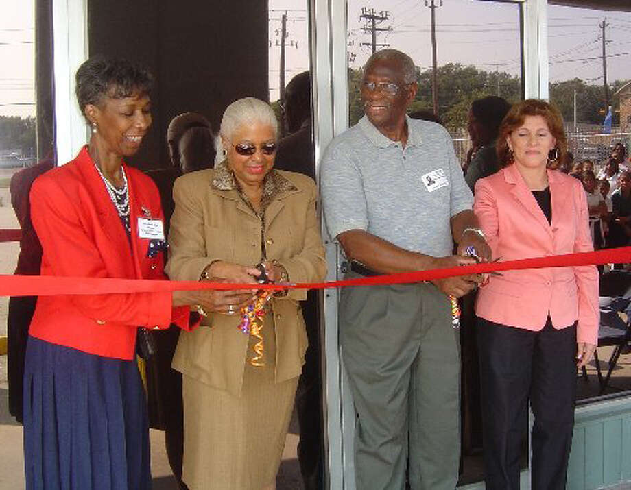 M. Annette Cluff, second from left, attends a ribbon-cutting for an expanded Varnett charter school campus in September 2006.