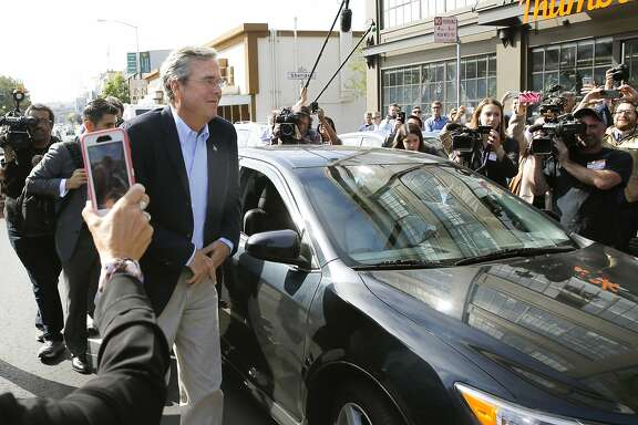 GOP presidential candidate Jeb Bush arrives at Thumbtack via a Uber car in San Francisco, Calif., on Thurs. July 16, 2015.