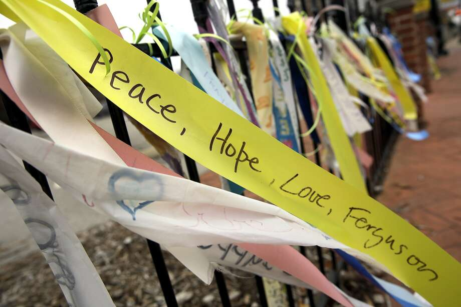 Ribbons flutter from a wrought-iron fence in Ferguson, Mo. Photo: Jeff Roberson, Associated Press