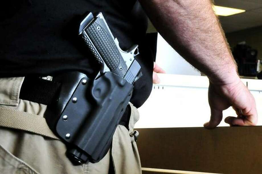 Texas' new open-carry law, which goes into effect Jan. 1, will allow only those with concealed handgun licenses to visibly carry those weapons as long as they are kept in a holster.