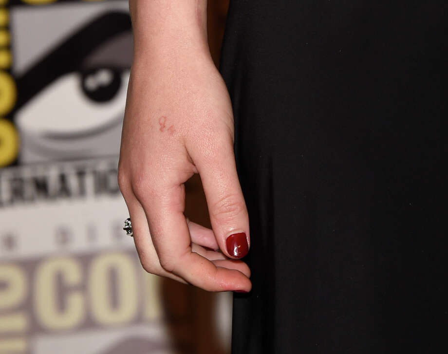 Jennifer Lawrence's tattoo could be seen at Comic-Con this year. Can you spot the mistake? At least she had it made very small. See if you can guess these other celebs by just their tattoos. Photo: Jason Merritt / Staff / 2015 Getty Images