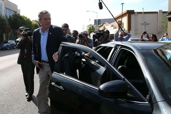 SAN FRANCISCO, CA - JULY 16:  Republican presidential candidate and former Florida governor Jeb Bush gets out of an Uber car as he arrives at Thumbtack on July 16, 2015 in San Francisco, California.  Republican presidential hopeful Jeb Bush toured Thumbtack, a consumer service company for hiring local professionals.  (Photo by Justin Sullivan/Getty Images)