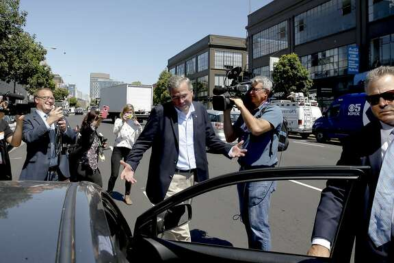 GOP presidential candidate Jeb Bush heads back into a Uber car after meeting with employees at Thumbtack in San Francisco, Calif.,  on Thurs. July 16, 2015.