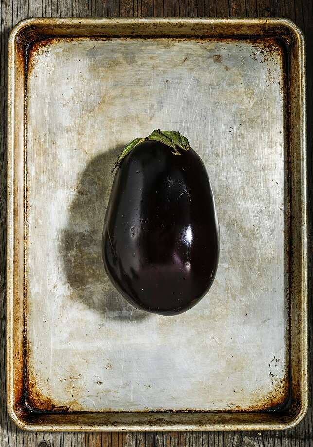 Whether round like this globe eggplant or elongated, this fruit can be baked, grilled or stewed. Photo: Russell Yip, The Chronicle