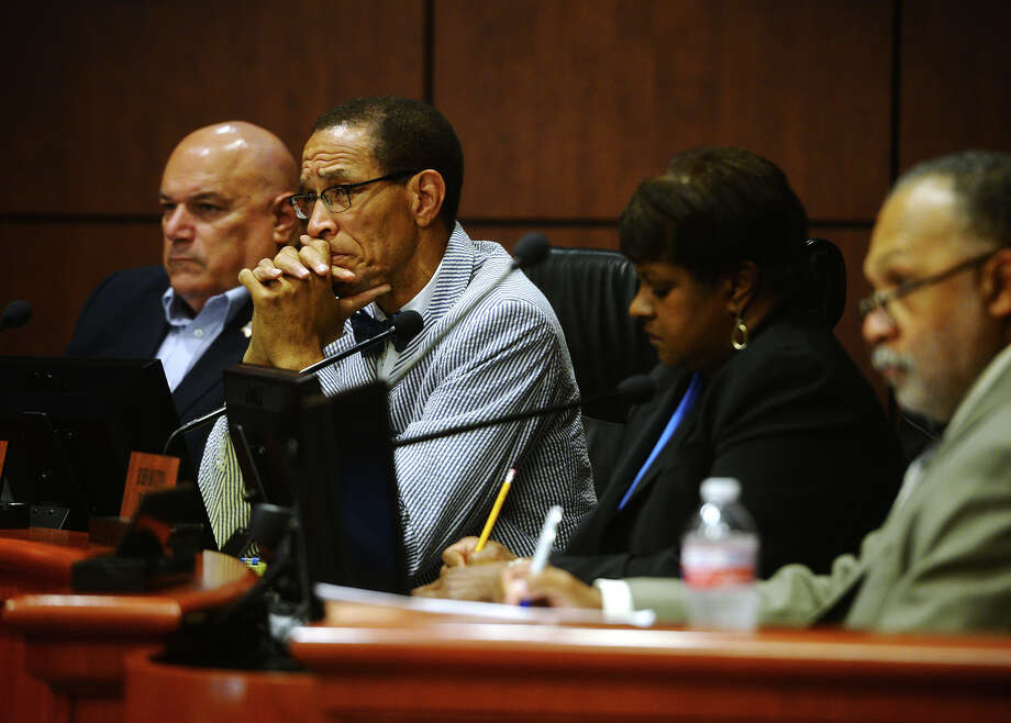"""Audwin Samuel and other members of the Beaumont City Council listen as Hani Tohme presents his story during a special """"name-clearing"""" hearing Thursday. Tohme, former director of Beaumont's water utilities, presented his case in the 45-minute hearing before the Beaumont City Council on Thursday afternoon. Photo taken Thursday 7/9/15 Jake Daniels/The Enterprise Photo: Jake Daniels / ©2015 The Beaumont Enterprise/Jake Daniels"""