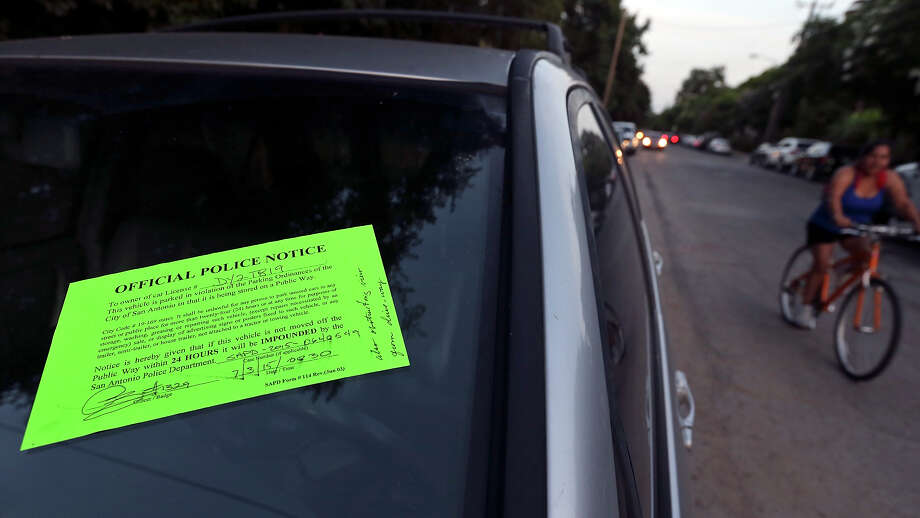 FILE PHOTO — An illegally parked car on Cedar Street in Southtown is ticketed by police during First Friday. A proposal to help alleviate parking problems in the neighborhood and commercial corridor is expected to be completed in May, with approval to come later. Click to see the impacted streets in the proposed plan. Photo: Edward A. Ornelas /San Antonio Express-News / © 2015 San Antonio Express-News