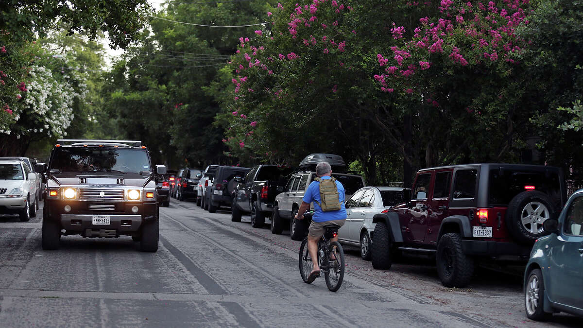 A cyclist rides with traffic in early July on Madison Street, in the Southtown neighborhood.