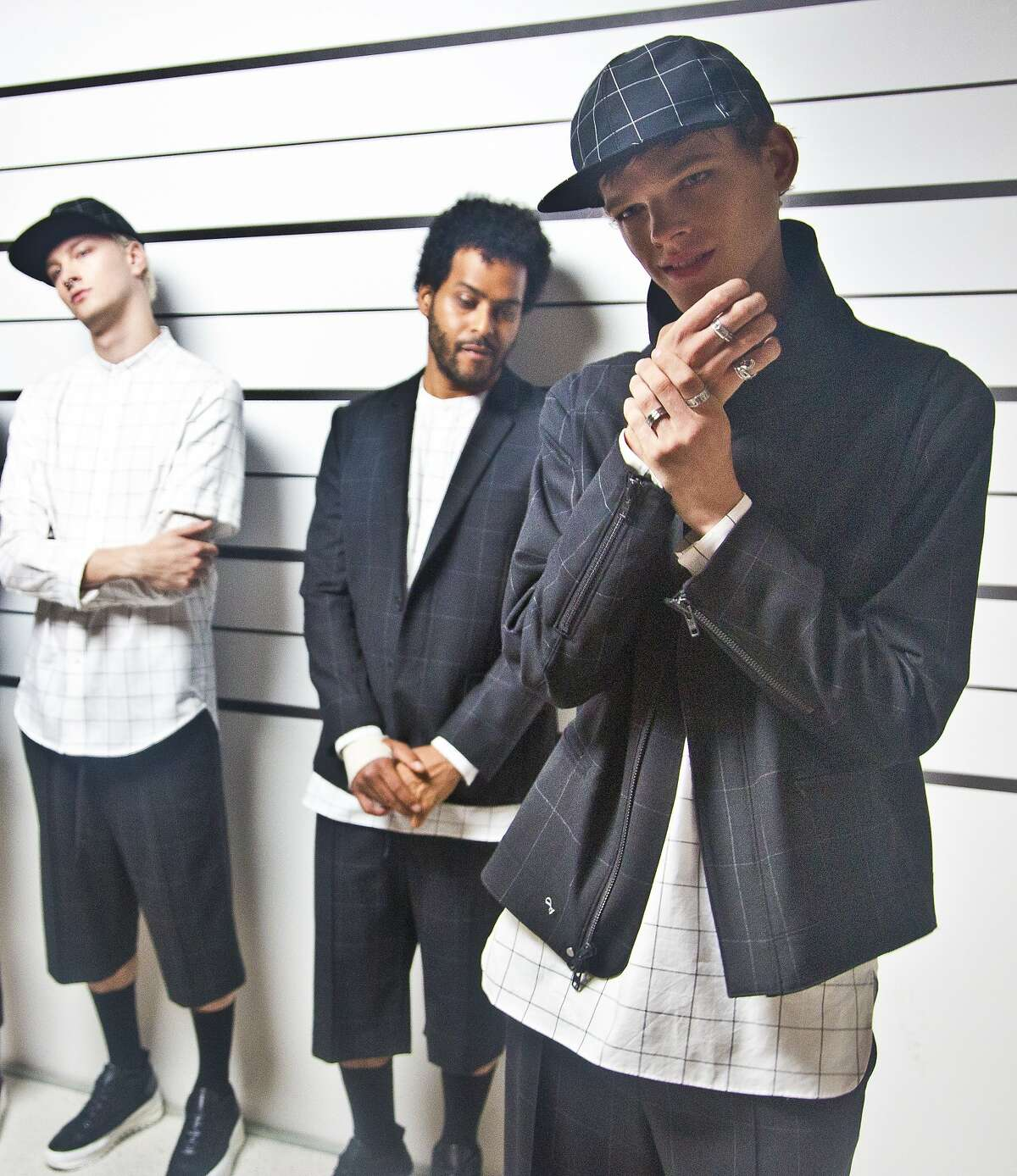 Fashion from Public School is modeled in a police line-up themed presentation on, Tuesday, July 14, 2015, in New York. (AP Photo/Bebeto Matthews)