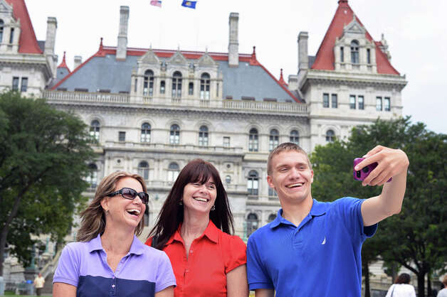 Jacob Vassalotti, right, of Newark, Delaware takes a selfie with his aunt Christy Smart of Chesapeake, Virginia, and mother Tina Vassalotti, left, in front of the state Capitol Wednesday July, 15, 2015 in Albany, NY. The trio is visiting the Capital District as Jacob checks out RPI and Union College.  (John Carl D'Annibale / Times Union) Photo: John Carl D'Annibale, Albany Times Union