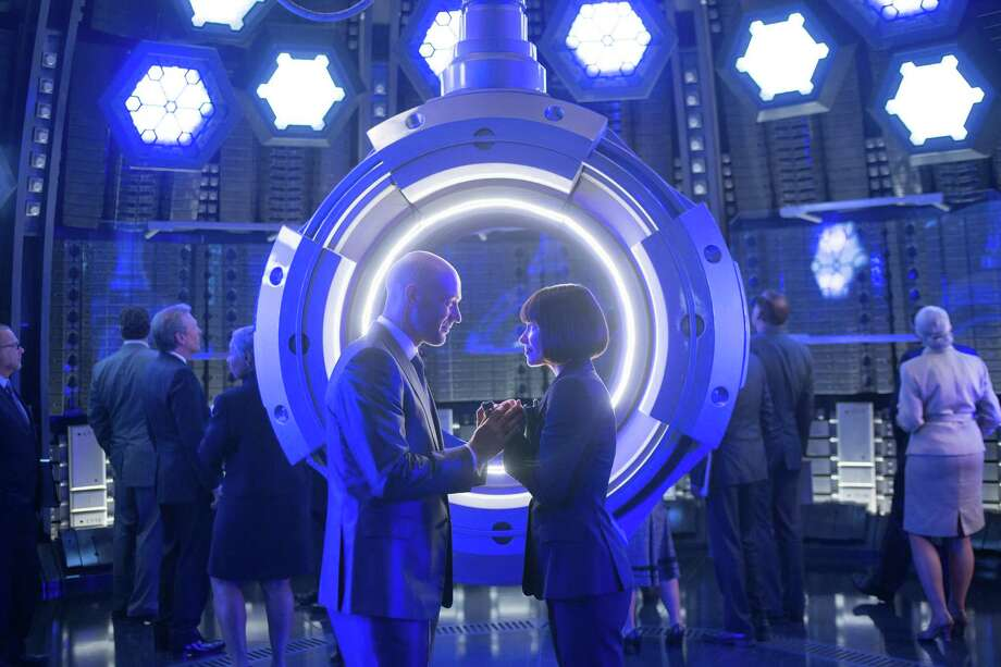 "This photo provided by Disney shows Corey Stoll, left, as Darren Cross, and Evangeline Lilly as Hope Van Dyne, in a scene from Marvel's ""Ant-Man."" (Zade Rosenthal/Disney/Marvel via AP) ORG XMIT: CAET330 Photo: Zade Rosenthal / Disney/Marvel"