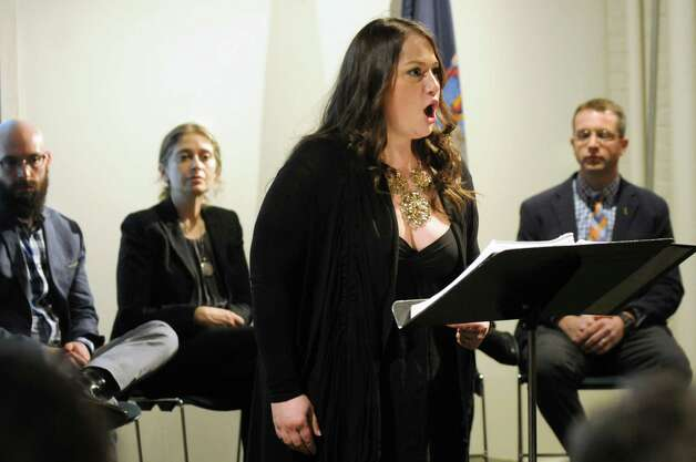 "Mezzo soprano Heather Johnson, center, performs a song from the opera ""The Long Walk"" on Thursday, March 12, 2015, at the New York State Military Museum in Saratoga Springs, N.Y. Joining her, from left, are Opera Saratoga's Jeremy Howard Beck and Stephanie Fleischmann and author Brian Castner. A reading, discussion and performance introduced an opera based on Castner's Iraq War memoir that's being developed by Opera Saratoga. (Cindy Schultz / Times Union) Photo: Cindy Schultz / 00030993A"