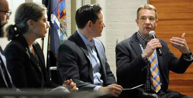 "Brian Castner, right, author of ""The Long Walk,"" talks about his Iraq War memoir on Thursday, March 12, 2015, at the New York State Military Museum in Saratoga Springs, N.Y. A reading, discussion and performance introduced an opera based on Castner's book that's being developed by Opera Saratoga for its world premiere in July. (Cindy Schultz / Times Union) Photo: Cindy Schultz / 00030993A"