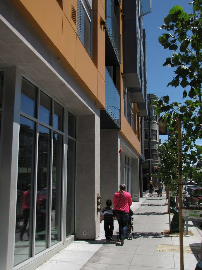 The new 18-unit condominium building at 20th and Valencia streets won't win design awards, but it has a visual clarity and snap missing from other examples of infill housing added to the Mission District during the current boom. Photo: John King, The Chronicle