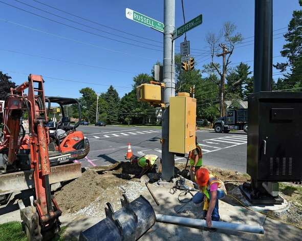 Construction continues at the intersection of Russell Road and Western Avenue where another red-light camera will be put in place Thursday afternoon, July 16, 2015, in Albany, N.Y. Two intersections selected to receive red light cameras in the city of Albany will be going live on Monday morning after midnight. (Skip Dickstein/Times Union) Photo: SKIP DICKSTEIN / 00032626A