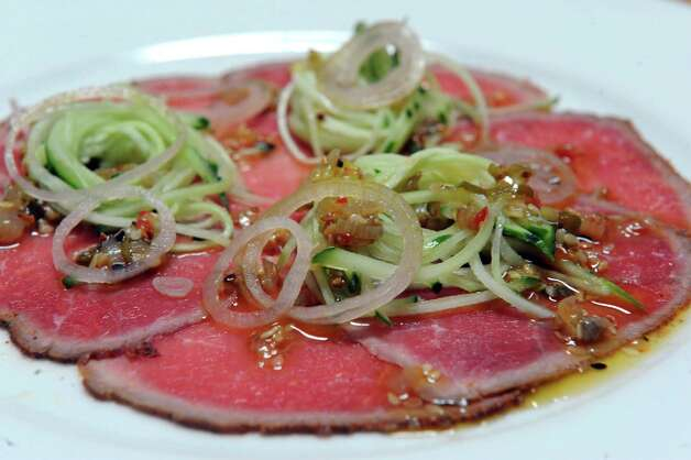 Kinderhook farm beef carpaccio at Swoon Kitchenbar at 340 Warren Street on Friday July 10, 2015 in Hudson, N.Y. (Michael P. Farrell/Times Union) Photo: Michael P. Farrell / 00032545A