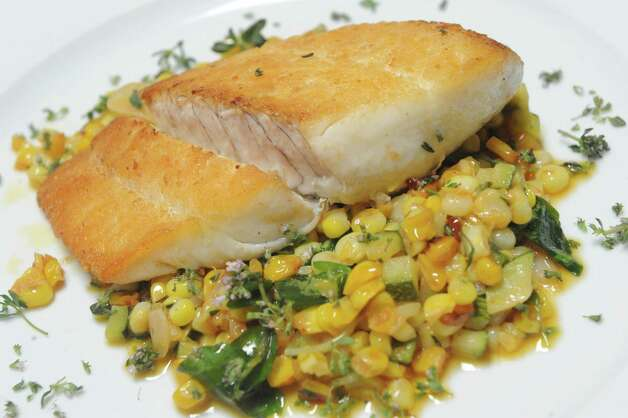 Fluke with local corn and zucchini succotash at Swoon Kitchenbar at 340 Warren Street on Friday July 10, 2015 in Hudson, N.Y. (Michael P. Farrell/Times Union) Photo: Michael P. Farrell / 00032545A