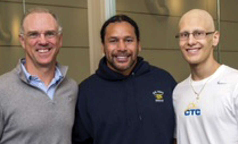 Troy Polamalu former Pittsburgh Steeler, center, recently visited the CT Challenge Center for Survivorship in Southport to train with Giacomo Brancato, right. Joining them is Jeff Keith, the CEO of CT Challenge. Photo: Contributed Photo / Fairfield Citizen