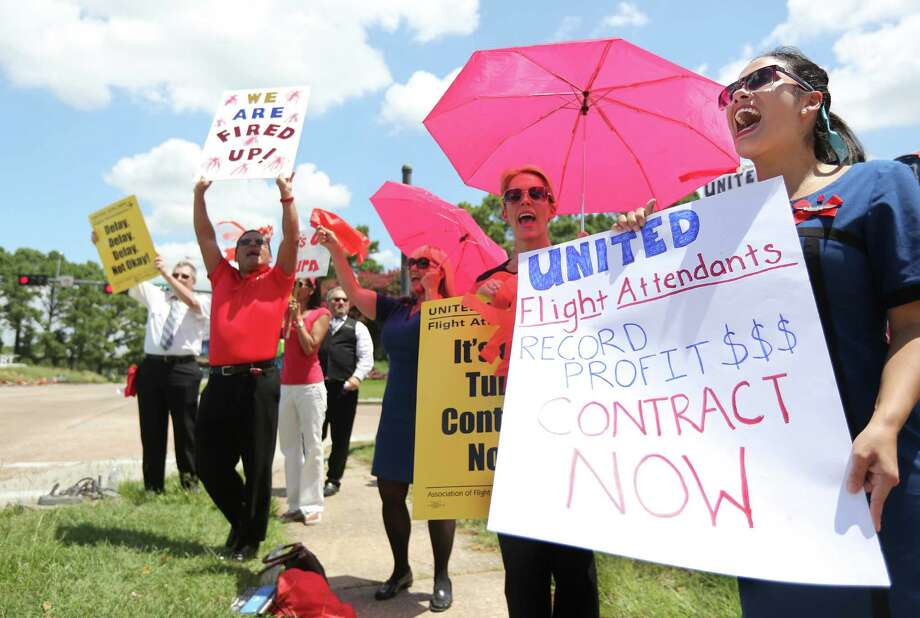 United Airlines Flight Attendants protest near the entrance to George Bush Intercontinental Airport joining flight attendants around the world to support of negotiations for a fair contract on Thursday, July 16, 2015, in Houston.  ( Mayra Beltran / Houston Chronicle ) Photo: Mayra Beltran, Staff / © 2015 Houston Chronicle