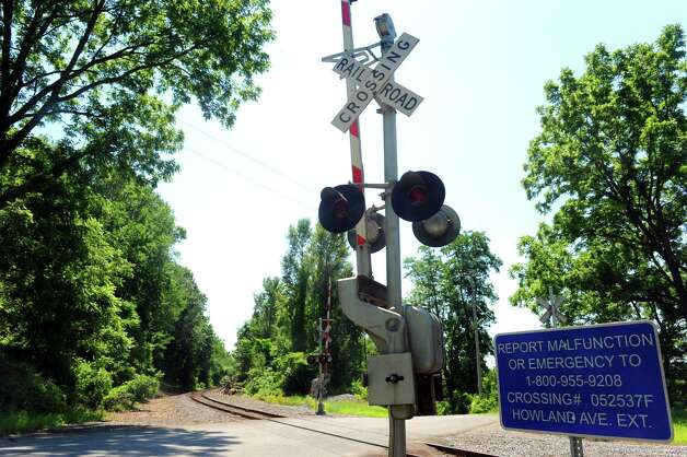 A rail crossing on Howland Avenue Extension near Allen Road on Thursday, July 16, 2015, in Schaghticoke, N.Y. An intoxicated man who fell asleep on train tracks was miraculously uninjured when a freight train rolled over him late Wednesday night, State Police said. (Michael P. Farrell/Times Union) Photo: Michael P. Farrell / 00032650A
